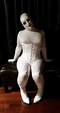 A picture of Evil Dolly sitting in her dungeon.